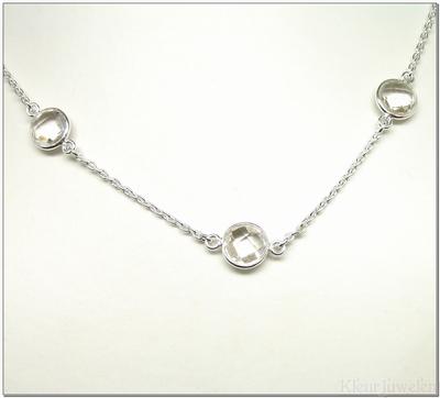 Zilveren ketting met ronde, facet geslepen bergkristal