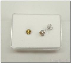 Zilveren ronde citrien oorstekers open zetting