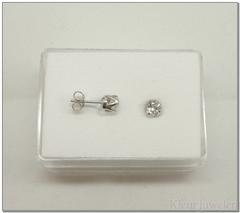 Zilveren ronde topaas oorstekers open zetting
