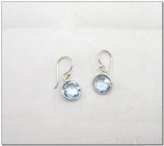 Zilveren oorbellen met ronde topaas