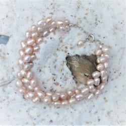 Dubbele armband met roze...